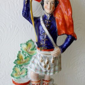 Staffordshire Figure Scottish Soldier with Flag H 907