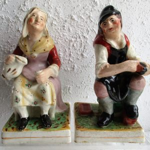 Pair of Staffordshire Figures A Cobbler and his Wife H 2183 H 2184